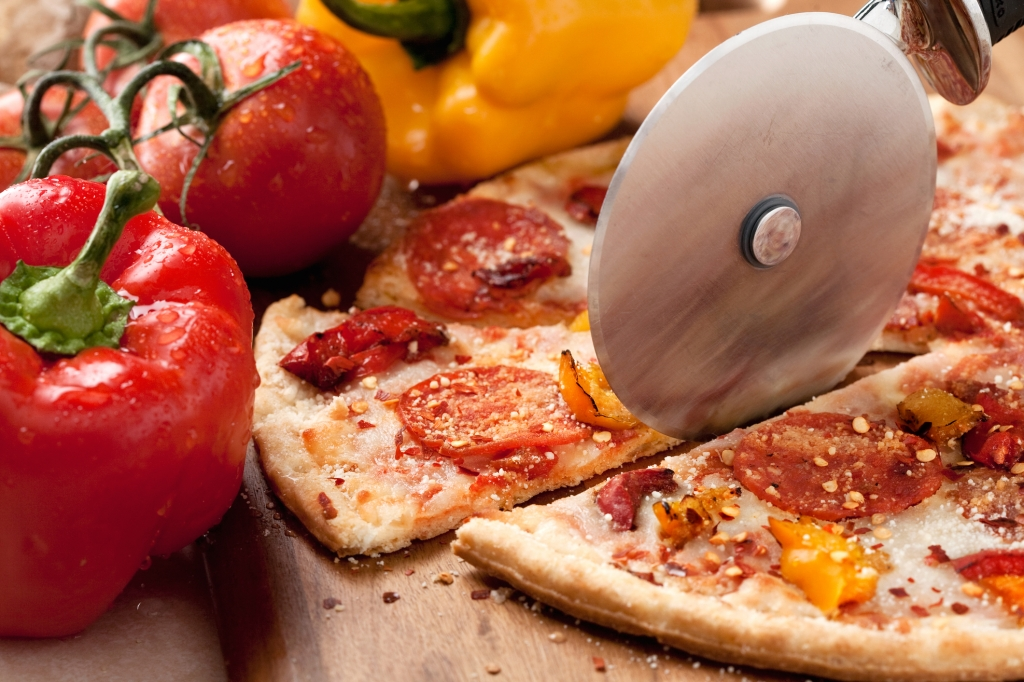 Pizza making tools and cherry tomato with pesto